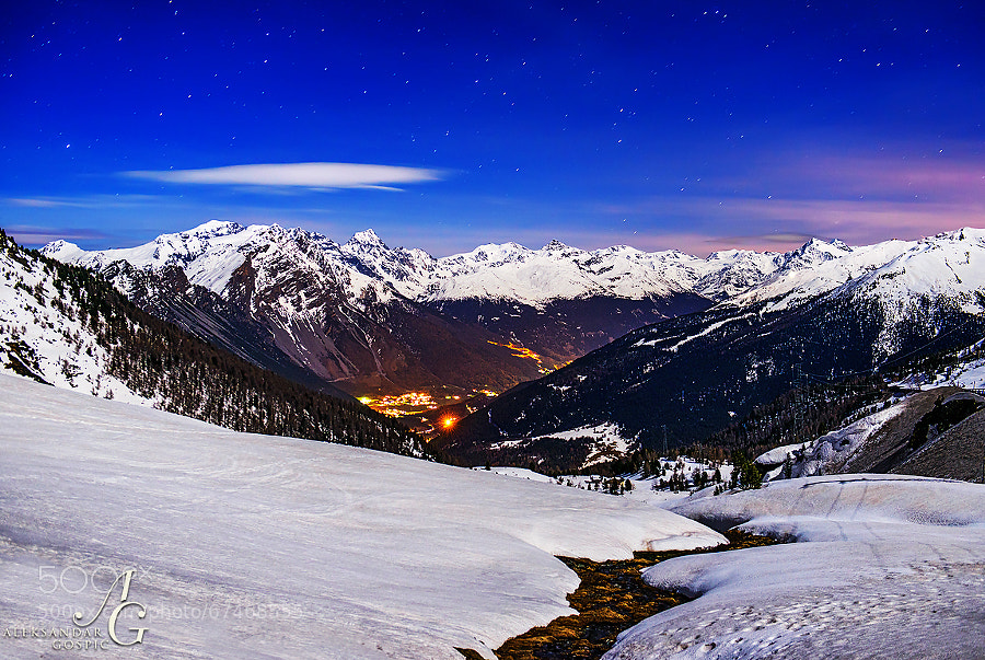 Ortler Alps, led by wide Ortler (3905m) and sharp Königspitze (3851m) on the left, bathed in moonlight night