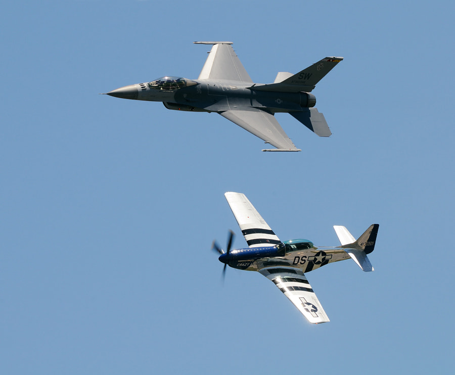 On the lower side a North American TF-51D Mustang and on top an USA - Air Force Lockheed F-16CM Fighting Falcon in a Heritage Flight during an Airshow at the Marine Corps Air Station in Beaufort, South Carolina, USA.  Happy Easter,  Harry