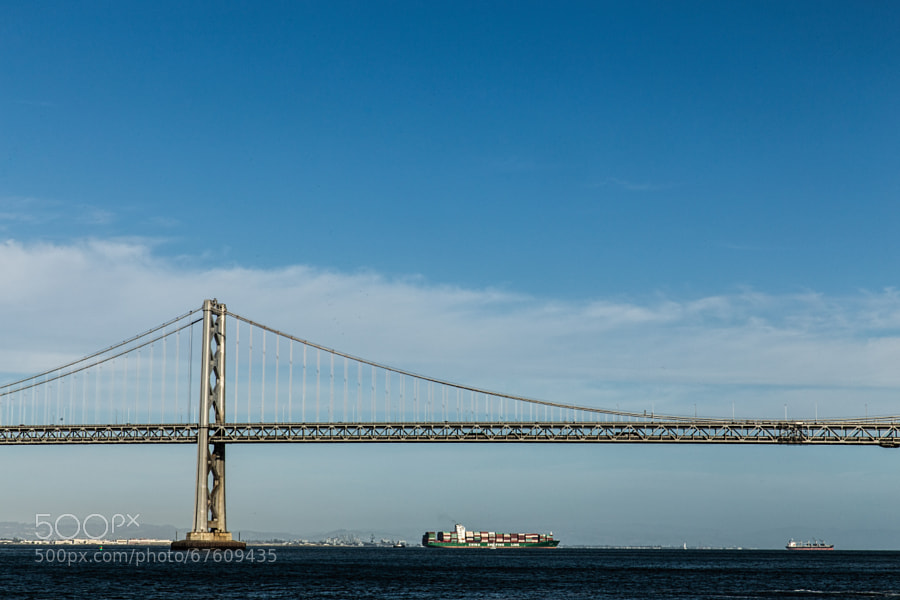Photograph Bay Bridge and Container Ship by John Mazzei on 500px