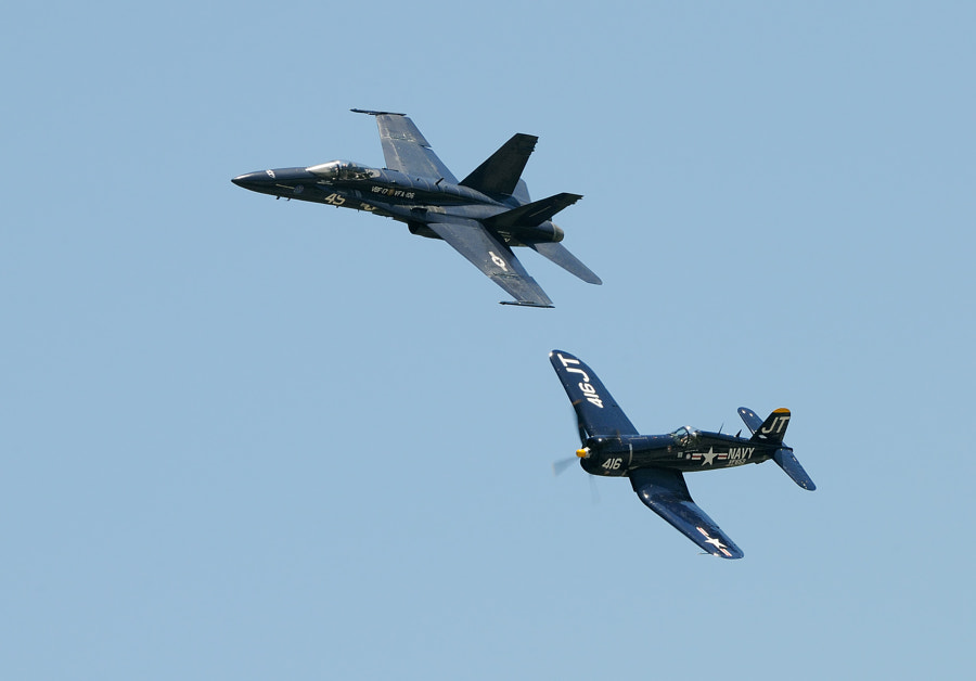 """Legacy Flight of a Vought F4U-4 Corsair and an USA - Navy Boeing F/A-18F Super Hornet of the VFA-106 Virtual Tactical Demonstration Squadron Team """"Gladiators"""".  Shot taken during an Airshow at the Marine Corps Air Station in Beaufort, South Carolina, USA.  Best regards and a Happy Easter,  Harry"""