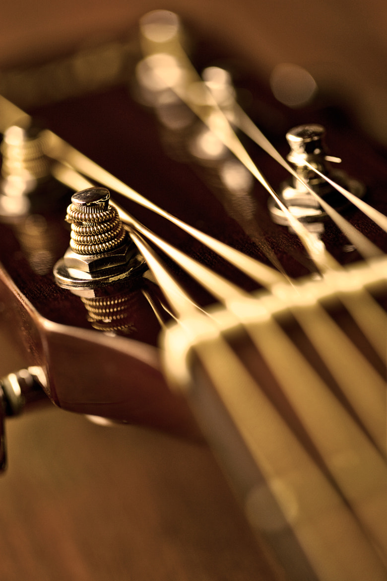 Photograph Acoustic guitar golden by Mauro Woiski on 500px