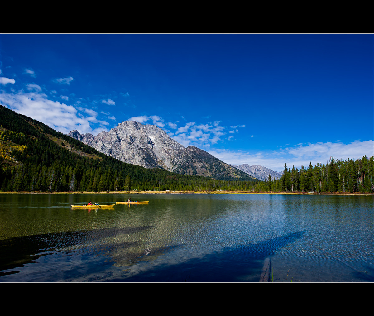 Photograph String Lake Kayakers by Wil Bloodworth on 500px