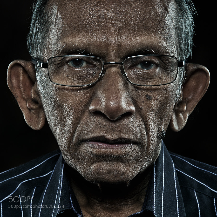 Pak Yus, veteran malay lyricist from Singapore in hyper portrait style.