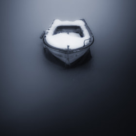 Boat on icy lake by nicoimages  on 500px.com