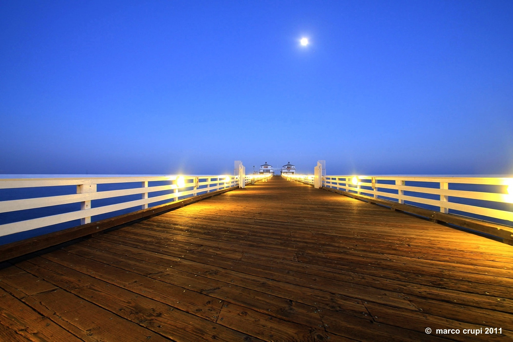 Photograph Moonlit Pier by Marco Crupi on 500px