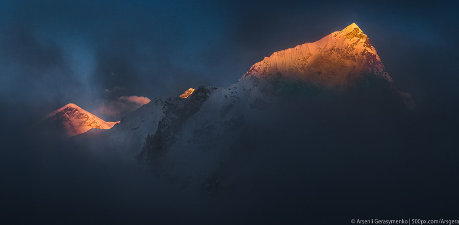 Everest Mt. Peak and Nuptse at cloudy sunset by Arsenii Gerasymenko on 500px.com