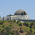 """Griffith Observatory's unique architecture and setting, compelling programmatic offerings, and cinematic exposure have made it one of the most famous and visited landmarks in southern California. Tens of millions have come to walk the inside of the building, view the live planetarium shows, or simply gaze out towards the coast and the heavens. This cultural and scientific icon owes its existence to the dream of one man, Griffith Jenkins Griffith, and to the dedicated scientists and public servants who worked to fulfill his vision of making astronomy and observation accessible to all.  A Great City Needs a Great Park  The land on which Griffith Observatory sits was once a part of a Spanish settlement known as Rancho Los Felis. The Spanish Governor of California bequeathed it to Corporal Vincente Felis in the 1770s. The land stayed in the Felis family for over a century, being subdivided through generations, until Griffith, a wealthy mining speculator, purchased what remained of the rancho in 1882.  Griffith J. Griffith was born in Wales in 1850 and came to America as a teenager. He worked as a journalist and mining advisor before making his fortune in Mexican silver mines and, subsequently, southern California real estate. He moved to Los Angeles after purchasing the rancho and spent the rest of his life there. Griffith enjoyed being referred to as ?Colonel Griffith?, though it seems he was never officially commissioned as an officer (nor is it clear that he even served in the military).  During a tour abroad, Griffith had discovered the great public parks of Europe and decided that his home, Los Angeles, would need a """"Great Park"""" for the public in order to become a great city. On December 16, 1896, he donated 3,015 acres of Rancho Los Felis to the City of Los Angeles in order to create a public park in his name. """"It must be made a place of rest and relaxation for the masses, a resort for the rank and file, for the plain people,"""" Griffith said on that occasion. """"I co"""