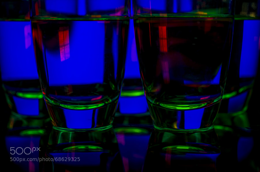 5 Transperant GLasses filled with clear water and added to the composition cpoloured lights