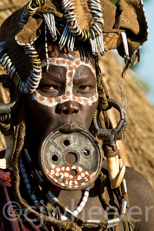 Photograph Mursi woman with lip plate. by Cindy Wheeler on 500px