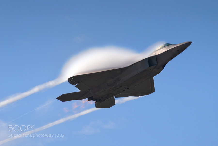 F-22A Raptor creates a cloud of vapor as it pulls into a climb over Dobbins ARB