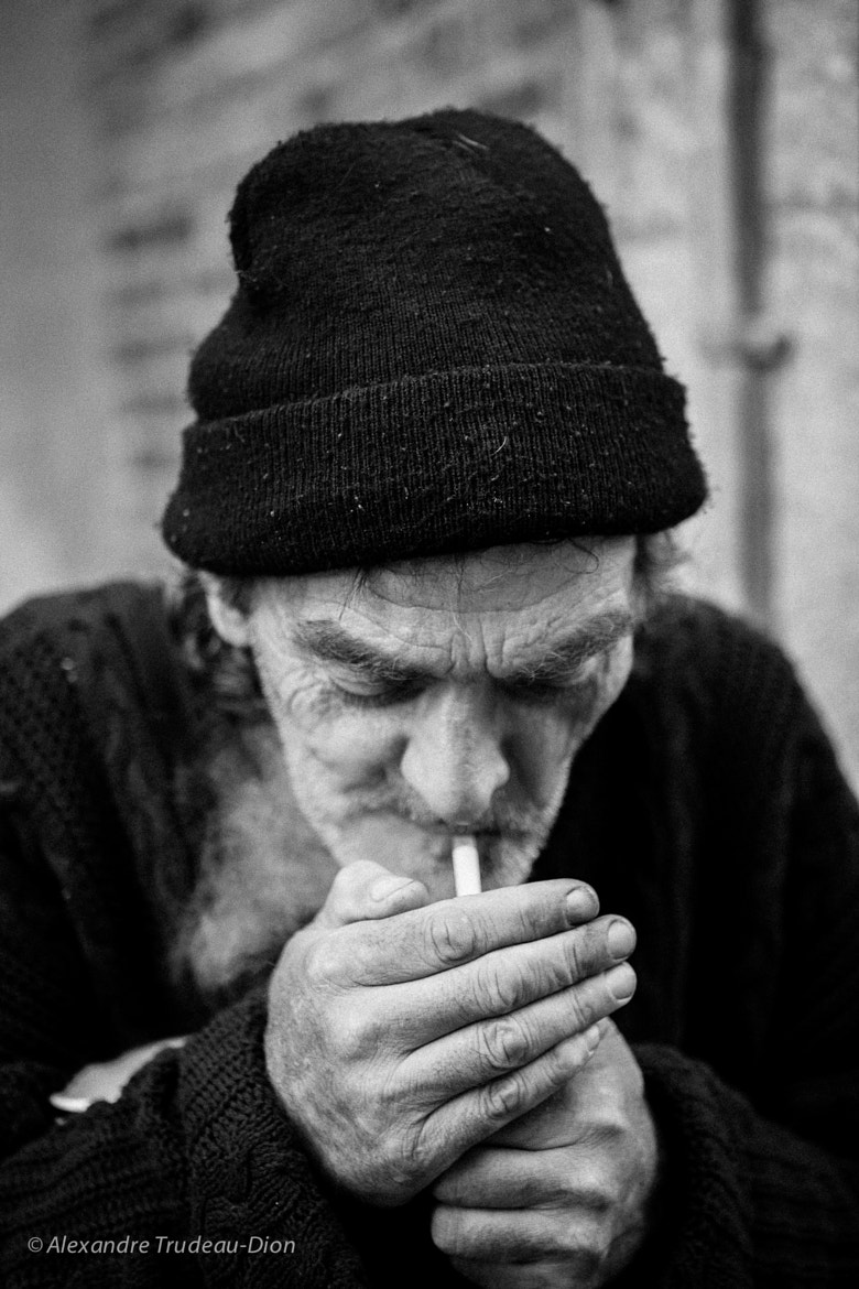 Photograph Smoking beggar by Alexandre Trudeau-Dion on 500px