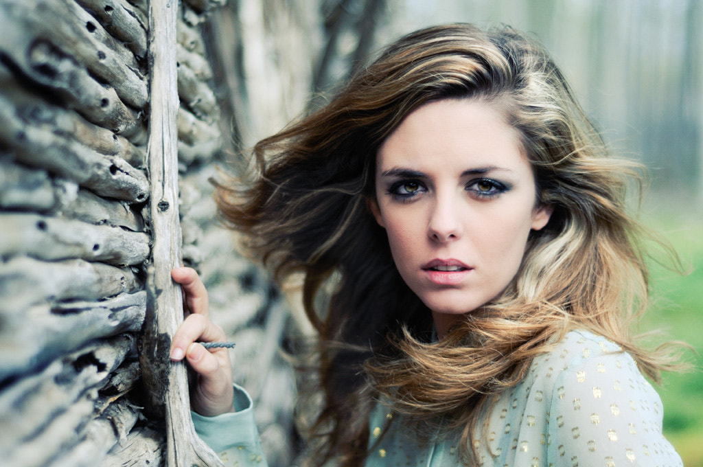 Photograph Beautiful blonde woman standing by a old wall by Javier Sánchez on 500px