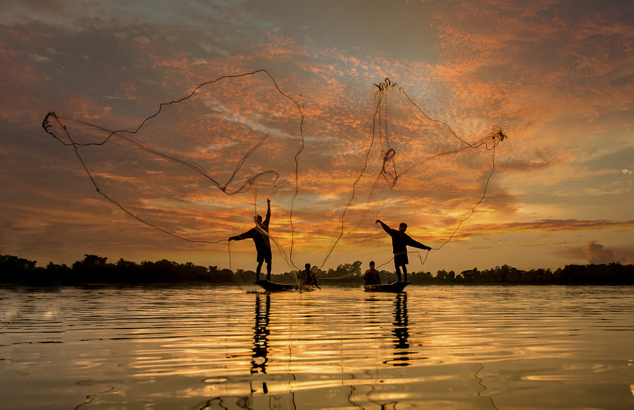Fisherman of Lake in action when fishing, Thailand by Sasin Tipchai on 500px.com