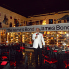 Постер, плакат: JAMES BOND LOOKALIKE at James Bond Museum
