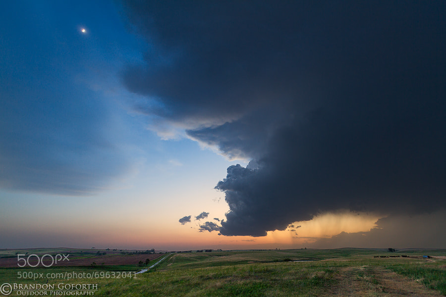 Photograph Decaying Storm Under A Twilight Moon by Brandon Goforth on 500px