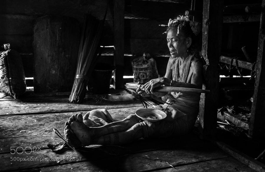 old mentawai woman preparing breakfast .