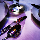 Постер, плакат: Stage Lights Reflected in Dinnerware