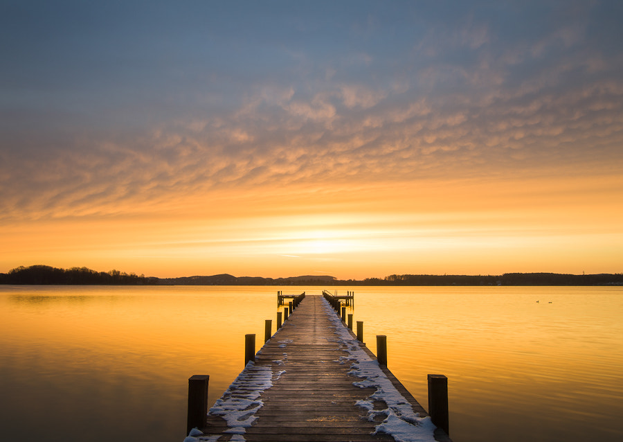 Photograph Sunrise at lake Wörthsee by Michael Mährlein on 500px