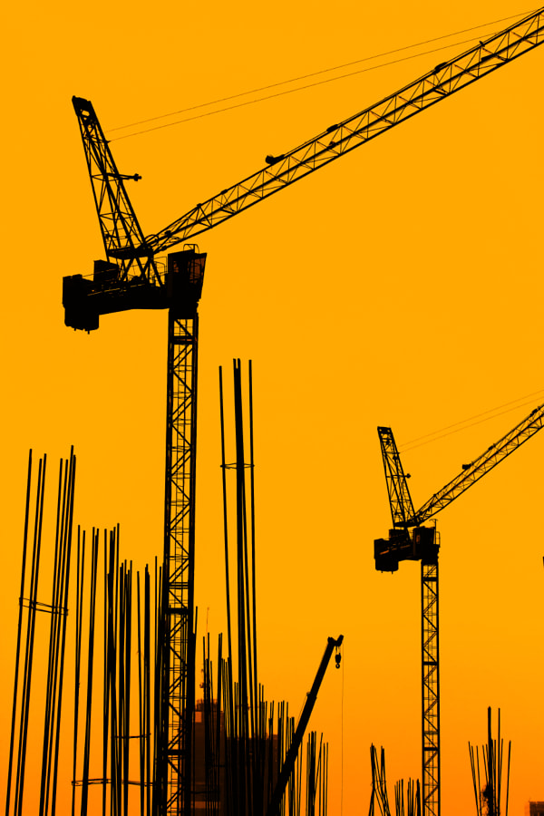 Photograph Building Construction with Cranes in the evening. by SAMART BOONYANG on 500px
