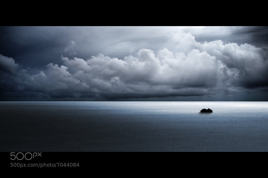 Photograph A Tiny Spot In The Vast Ocean by Carlos Gotay on 500px