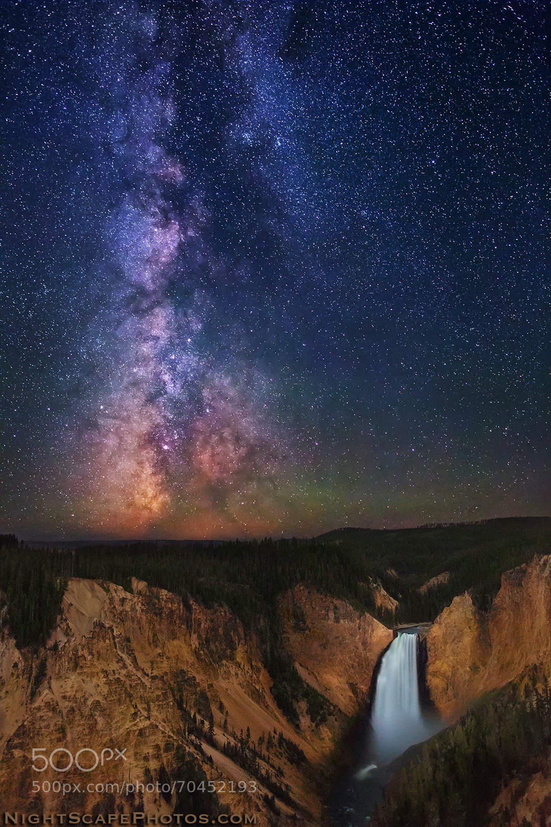milky way above yellowstone falls starscape