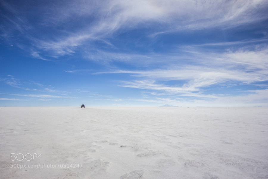 """""""Salar de Uyuni"""" is the world's largest salt flat at 10,582 square kilometers (4,086 sq mi). It is located in the Potosí and Oruro departments in southwest Bolivia, near the crest of the Andes and is at an elevation of 3,656 meters (11,995 ft) above mean sea level."""