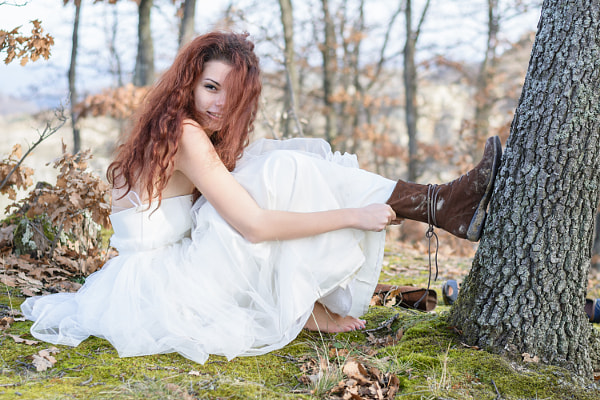 Photograph bride in the forest changing shoes by Catalin Grigoriu on 500px