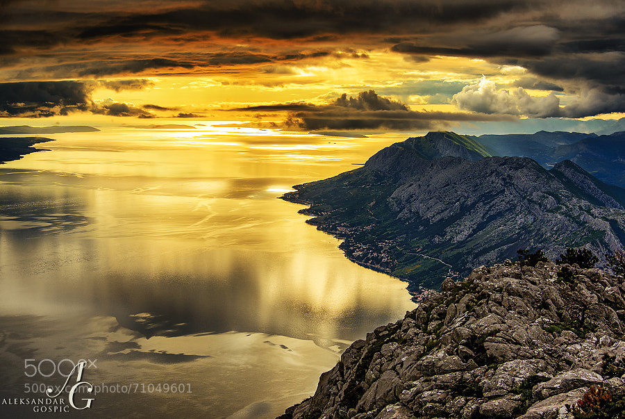 View from Biokovo mountain near the end of the day, down a Brač Channel towards the west, where after days of misery clouds of the outgoing cyclone Donat finally broke. On the right is Omiška Dinara mountain