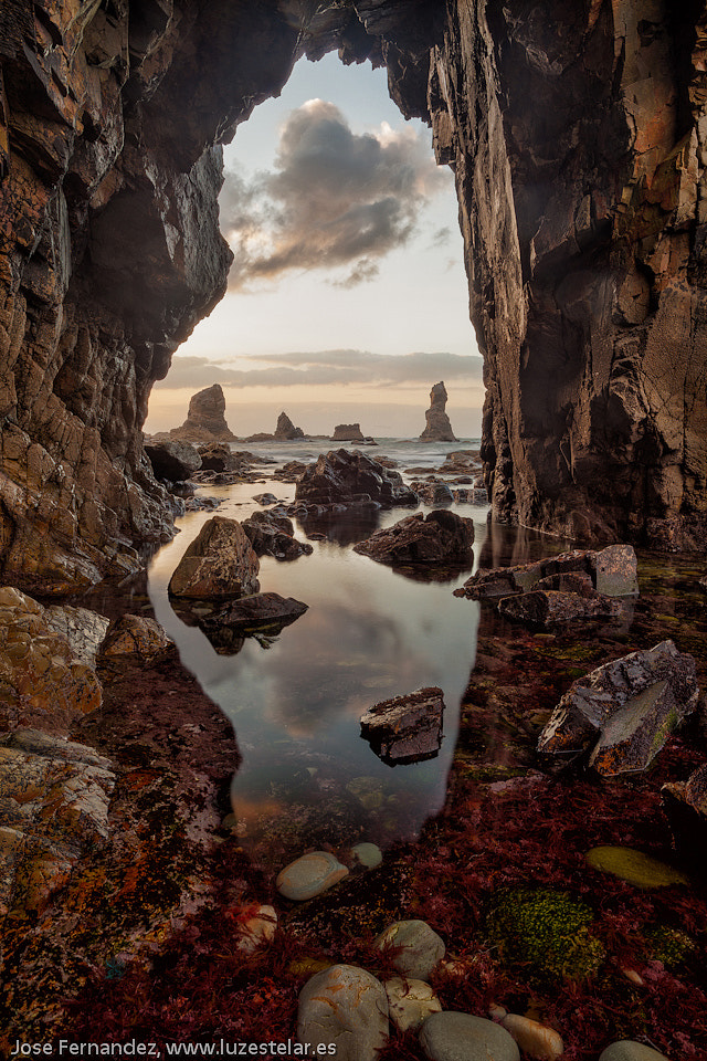 Photograph Reflections under the arc by Jose Fernandez on 500px