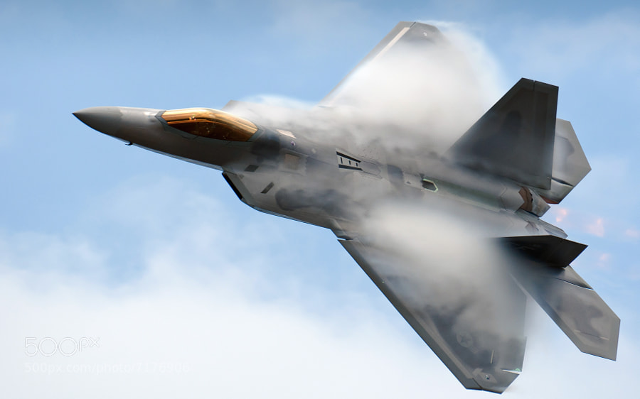 The F-22A Raptor performs the dedication pass with vapor flowing off the top of the airframe. 2012 Robins AFB Airshow