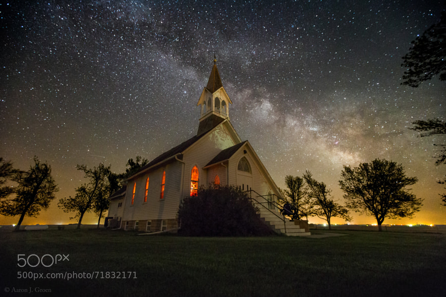 """""""Dakota Territory Milky Way"""" The historical Ben Clare United Methodist Church, Valley Springs, South Dakota with May 25th's clear sky at 1:53 am.  This is one of my favorite go to places for star shots, it is relatively close to where I live but just far enough to where you can see the milky may with the naked eye very well.  You may remember from over a year ago my first shot to do well on this website (500px), was this same church during a Kp7 aurora borealis... http://500px.com/photo/18148861  I have wanted to do a milky way shot here since last year but by the time I tried it was too late in the summer and the galactic center had already moved too far south to get it in the frame like this. This shot is a single exposure taken with a Canon EOS 6D and Canon EF 16-35 L II Lens at 16mm 15 second  f/3.2 10,000iso.  Tired of reading comments from ignorant people that think everything is PhotoShop, I decided to record a video with my phone of the camera taking this exact photo. You can see it here on my YouTube - <a href=""""https://www.youtube.com/watch?v=rz9FKo4kXG8"""" rel=""""nofollow"""">https://www.youtube.com/watch?v=rz9FKo4kXG8</a>  If you Like my work follow me on Facebook -  <a href=""""http://www.facebook.com/HomeGroenPhotography"""" rel=""""nofollow"""">www.facebook.com/HomeGroenPhotography</a> Or Google+ at  <a href=""""https://www.google.com/+AaronJGroen"""" rel=""""nofollow"""">www.google.com/+AaronJGroen</a>   Prints of my work are available at -  <a href=""""http://aaronj-groen.artistwebsites.com/"""" rel=""""nofollow"""">www.HomeGroenPhotography.com</a>"""