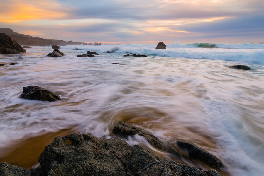 This was from my last full day shooting on my trip around California.    Based on a tip from a friend I made in Yellowstone, I headed over to Point Lobos from Death Valley.  While there, I visited spots up and down the coast, meeting a great photographer along the way (Ryan Engstrom).  This particular photo was taken as the sun was setting on the beach that was made famous a few years ago for the calla lilly-laden creek which runs into it.  Ryan and I had no luck getting a shot of the calla lillies, due to the onslaught of other photographers present, but the beach was definitely a nice treat.  I climbed on top of this rock as the waves crashed around me and waited until what seemed like the right moment.