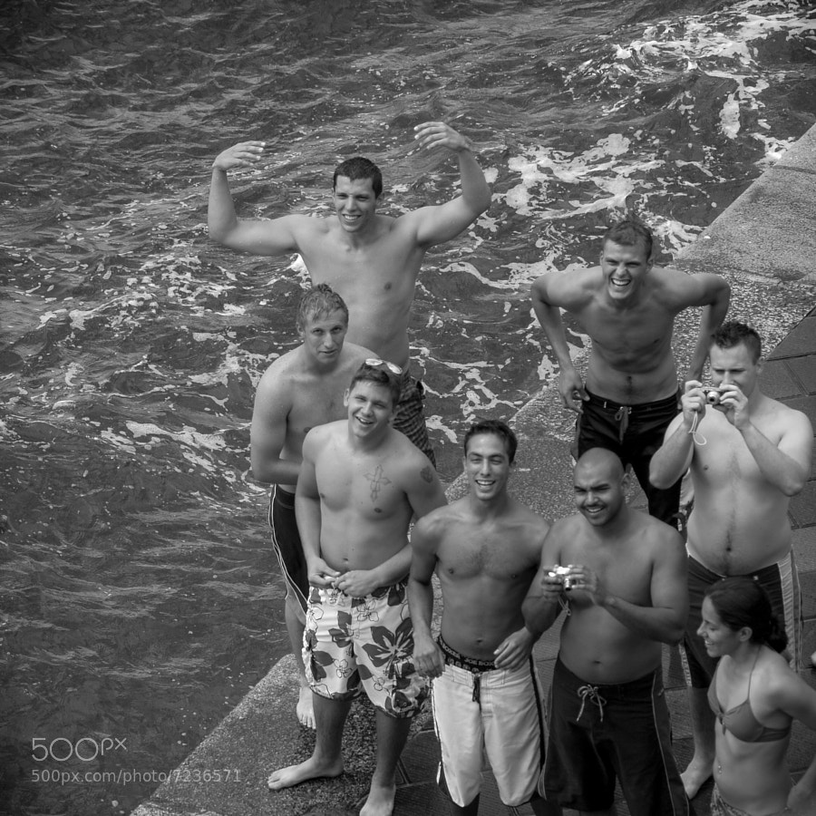 these guys were urging a friend to jump off a high rock