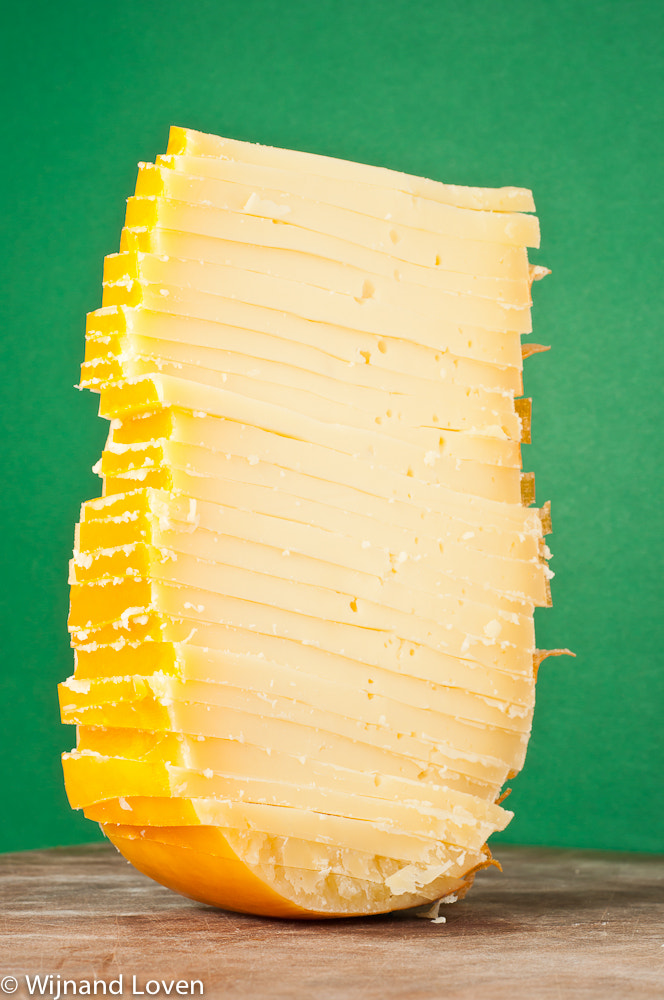 Photograph Sliced chunk of yellow cheese in original form by Wijnand Loven on 500px