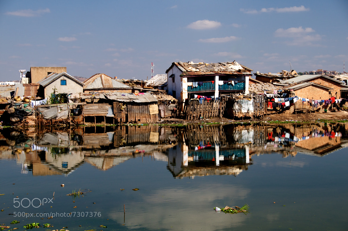 Photograph Slum reflection by Trevor Cole on 500px