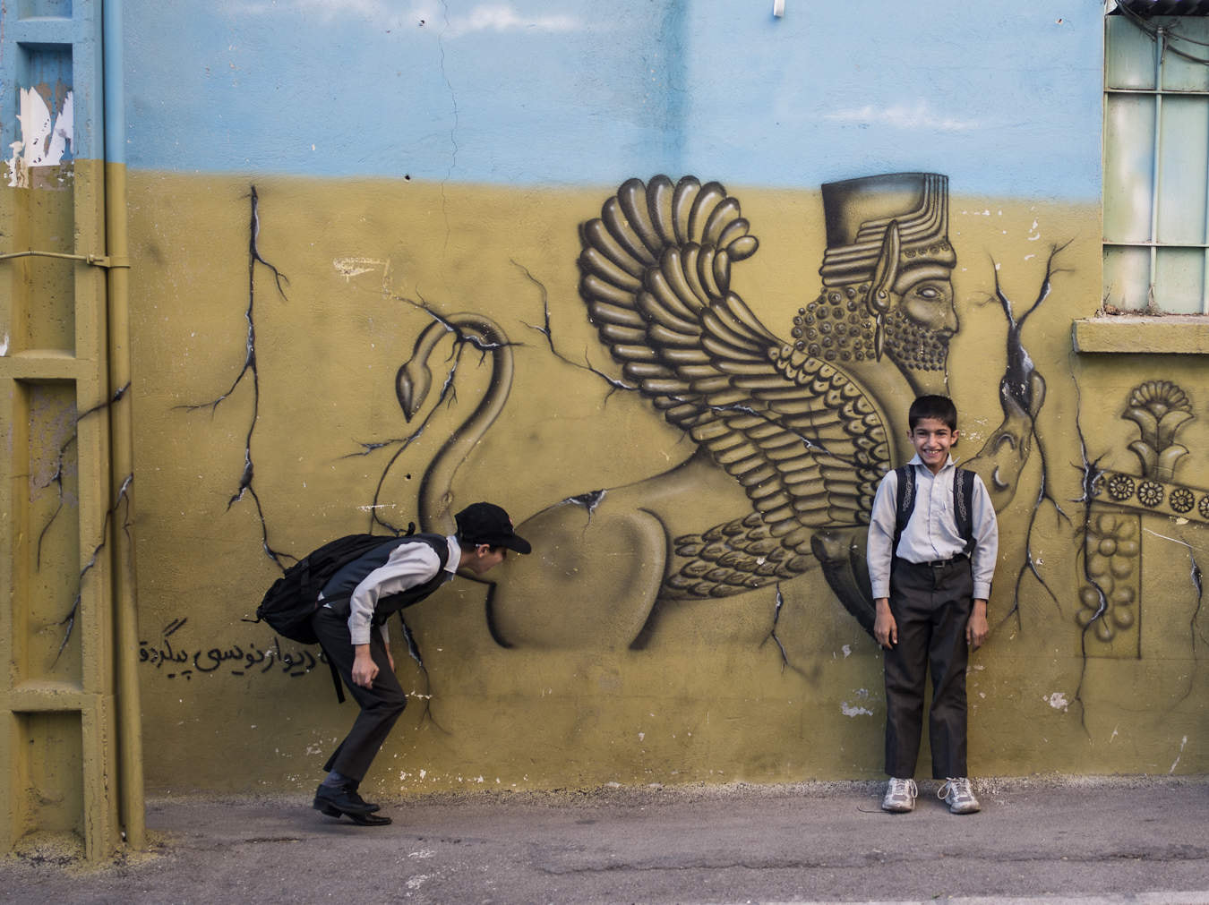 Photograph School boys & Mural, Shiraz, Iran by Chiaro Scurist on 500px