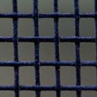 This photo is a macro shot of a screen door.