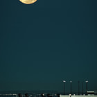 Full moon in perigee over Toronto City Airport. This was worth a run to Sugar Beach at 5 AM.