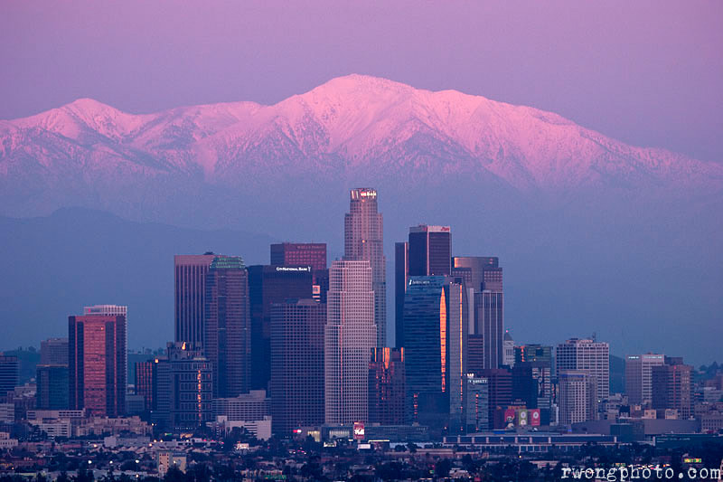 Photograph L.A. Skyline with Sunset Alpenglow on Snowy Mount Baldy Peak in Background, Southern California by Richard Wong on 500px