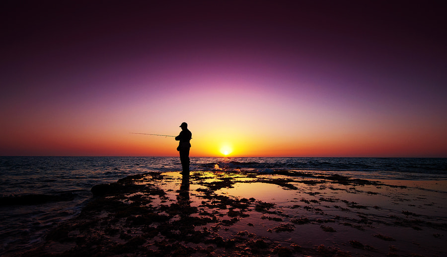 Photograph The Fisherman And The Sun by Guy Cohen on 500px