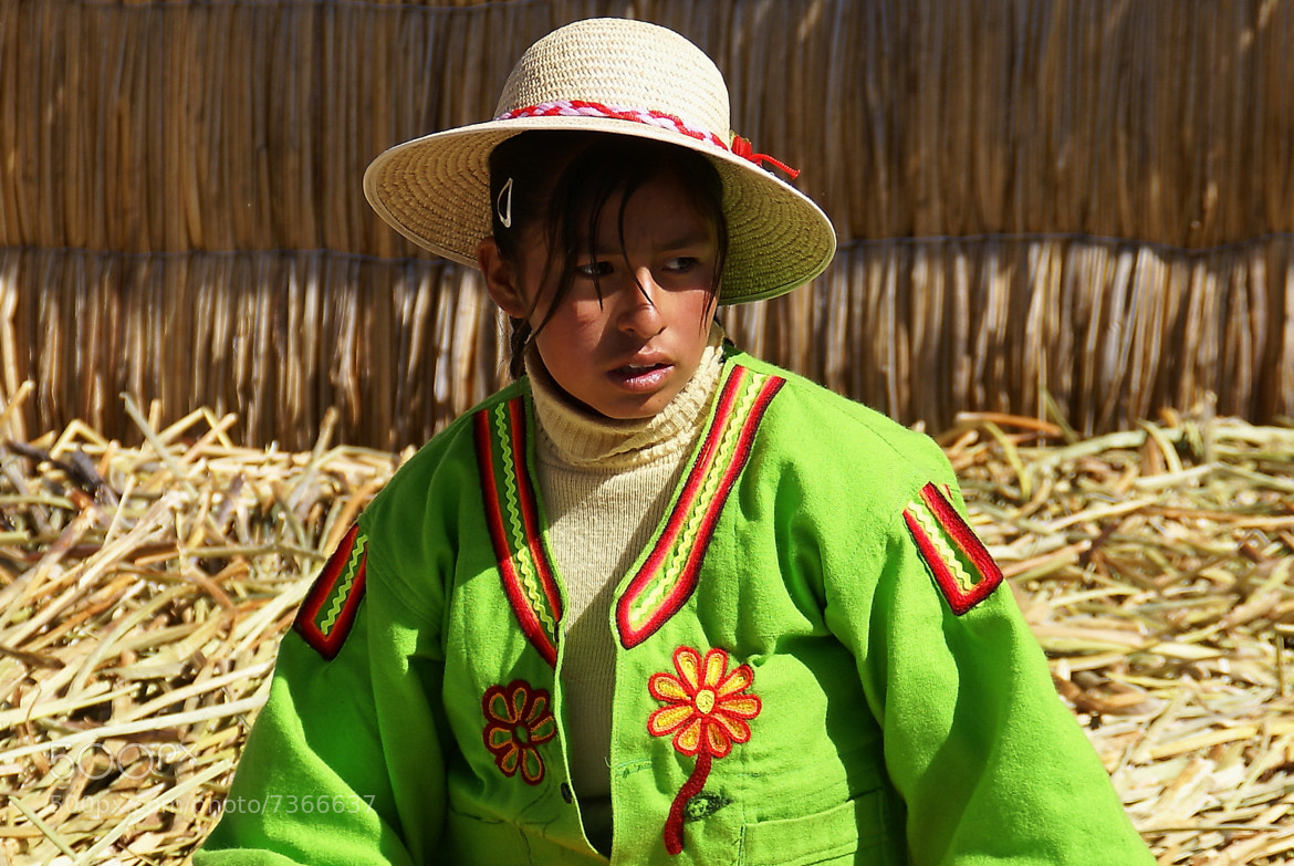 Photograph Girl of the floating island of Uros-2 by Branko Frelih on 500px