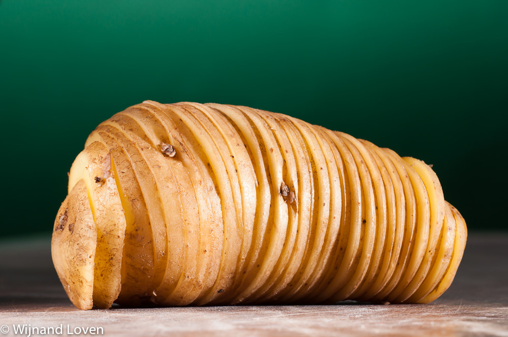 Photograph Unpeeled potato, sliced and put back into original form by Wijnand Loven on 500px