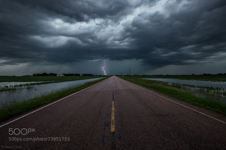 """Prints - <a href=""""http://homegroenphotography.com/"""">www.HomeGroenPhotography.com</a> Photo taken in last night's storm June 16th 8:08 pm on 463rd avenue by 290th street gravel. I stopped here for some quick shots because I had a small break in the rain but realized this was a very bad idea when I tried to leave. For a while I thought I was going to have to find the highest ground and wait til morning to try and drive home. It took me over 3 hours to find a way out of this area. Down every turn there was water flooded over the highway and even if I could have made it to the interstate it was closed already because water had even flooded across that as well. On the way here on the interstate I seen a semi flipped over and two cars in the ditch one completely submerged to the roof. Anyways noob lesson for today , do not stop in an area that is flooding to take lightning pics especially if on the way in many spots on the highway were already flooded over because it might keep flooding and leaving debris and washing out every gravel road so you can not get home  ;-)   <a href=""""http://www.facebook.com/HomeGroenPhotography"""">www.facebook.com/HomeGroenPhotography</a>"""