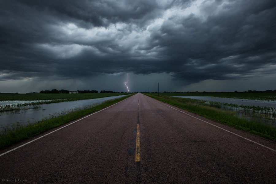 "Prints - <a href=""http://homegroenphotography.com/"">HomeGroenPhotography.com</a>  Photo taken in last night's storm June 16th 8:08 pm on 463rd avenue by 290th street gravel. I stopped here for some quick shots because I had a small break in the rain but realized this was a very bad idea when I tried to leave. For a while I thought I was going to have to find the highest ground and wait til morning to try and drive home. It took me over 3 hours to find a way out of this area. Down every turn there was water flooded over the highway and even if I could have made it to the interstate it was closed already because water had even flooded across that as well. On the way here on the interstate I seen a semi flipped over and two cars in the ditch one completely submerged to the roof. Anyways noob lesson for today , do not stop in an area that is flooding to take lightning pics especially if on the way in many spots on the highway were already flooded over because it might keep flooding and leaving debris and washing out every gravel road so you can not get home  ;-)   <a href=""http://www.facebook.com/HomeGroenPhotography"">www.facebook.com/HomeGroenPhotography</a>"