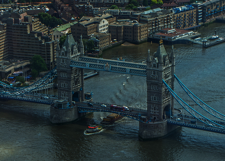 Tower Bridge and one of the still-working tugs, as seen from the Shard.  Having to shoot through glass made it awkward (for me!) but I do like the pov :)) Just a postcard!