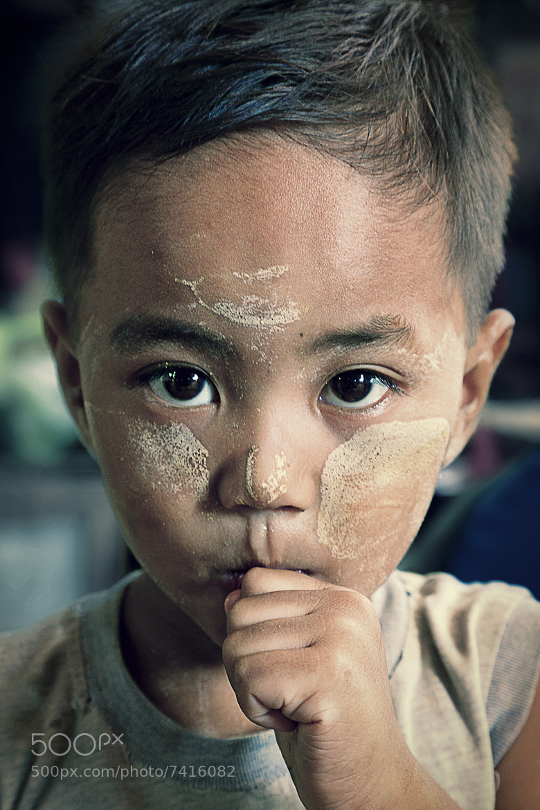Photograph Little boy at the market by Daniel Osterkamp on 500px