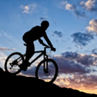 Постер, плакат: cyclist in the sunset