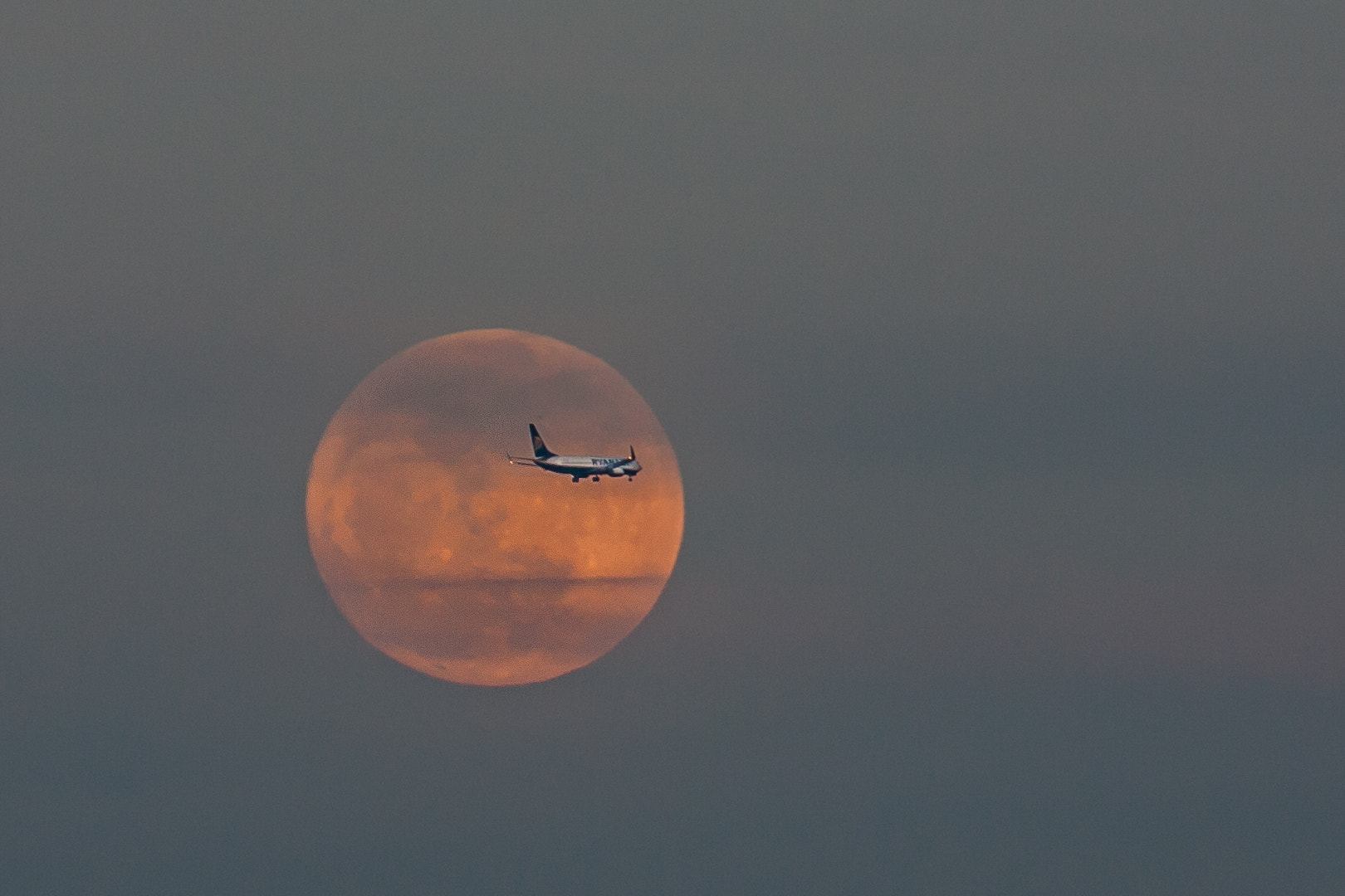 Photograph Super Full Moon with airplane by L. G. - luigig75 on 500px