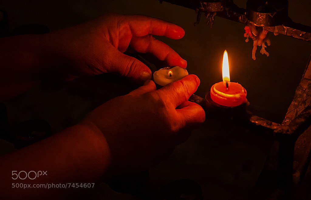 Photograph Lighting a candle. by willie bau on 500px