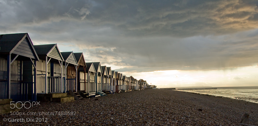 Photograph Beach Huts in a Storm by Gareth Dix on 500px